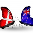 Stock Photo: Two butterflies with flags of Denmark and New Zealand on wings