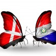 Stock Photo: Two butterflies with flags of Denmark and Paraguay on wings