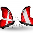 Stock Photo: Two butterflies with flags of Denmark and Peru on wings