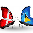 Stock Photo: Two butterflies with flags of Denmark and Saint Lucion wings