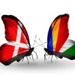 Stock Photo: Two butterflies with flags of Denmark and Seychelles on wings