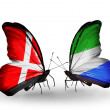 Stock Photo: Two butterflies with flags of Denmark and SierrLeone on wings