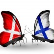 Stock Photo: Two butterflies with flags of Denmark and Finland on wings