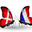Stock Photo: Two butterflies with flags of Denmark and France on wings