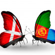 Stock Photo: Two butterflies with flags of Denmark and Eritreon wings