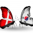 Stock Photo: Two butterflies with flags of Denmark and South Koreon wings