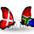 Stock Photo: Two butterflies with flags of Denmark and South Africon wings