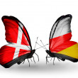 Stock Photo: Two butterflies with flags of Denmark and South Ossetion wings