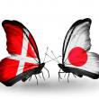 Stock Photo: Two butterflies with flags of Denmark and Japon wings