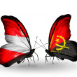 Stock Photo: Two butterflies with flags of Austriand Angolon wings