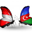Stock Photo: Two butterflies with flags of Austriand Azerbaijon wings