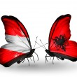 Stock Photo: Two butterflies with flags of Austriand Albanion wings