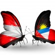 Stock Photo: Two butterflies with flags of Austriand Antiguand Barbudon wings