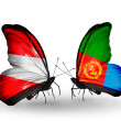 Stock Photo: Two butterflies with flags of Austriand Eritreon wings