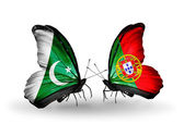 Two butterflies with flags of Pakistan and Portugal on wings — Stock Photo