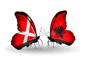 Two butterflies with flags of Denmark and Albania on wings — Stock Photo