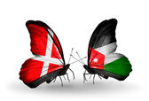 Two butterflies with flags of Denmark and Jordan on wings — Stock Photo