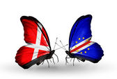 Two butterflies with flags of Denmark and Cape Verde on wings — Stock Photo