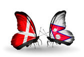 Two butterflies with flags of Denmark and Nepal on wings — Stock Photo