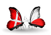 Two butterflies with flags of Denmark and Poland on wings — Stock Photo