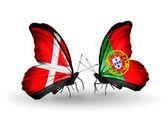 Due farfalle con bandiere di danimarca e portogallo sulle ali — Foto Stock