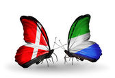 Two butterflies with flags of Denmark and Sierra Leone on wings — Stock Photo