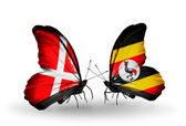 Two butterflies with flags of Denmark and Uganda on wings — Stock Photo
