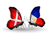Two butterflies with flags of Denmark and Philippines on wings — ストック写真