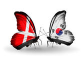 Two butterflies with flags of Denmark and South Korea on wings — Stock Photo