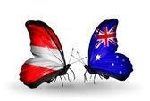 Dos mariposas con banderas de austria y australia con alas — Foto de Stock