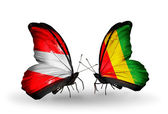 Two butterflies with flags of Austria and Guinea on wings — Stock Photo