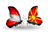Two butterflies with flags of Austria and Macedonia on wings — Stock Photo