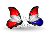 Two butterflies with flags of Austria and Holland on wings — Stock Photo