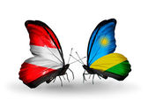 Two butterflies with flags of Austria and Rwanda on wings — Stock Photo
