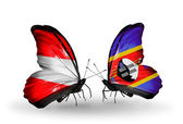 两只蝴蝶带有标志的奥地利和斯威士兰的翅膀 — 图库照片