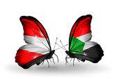 Dos mariposas con banderas de austria y sudán en alas — Foto de Stock