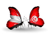 Two butterflies with flags of Austria and Tunisia on wings — Stock Photo