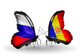 Two butterflies with flags of Russia and Andorra on wings — ストック写真