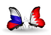 Two butterflies with flags of Russia and Bahrain on wings — Foto de Stock