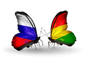 Two butterflies with flags of Russia and Bolivia on wings — Stock Photo
