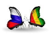 Two butterflies with flags of Russia and Guinea on wings — Stock Photo