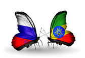 Two butterflies with flags of Russia and Ethiopia on wings — Stockfoto