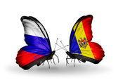 Две бабочки с флагами России и Молдавии на крыльях — Стоковое фото