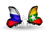 Two butterflies with flags of Russia and Myanmar on wings — Stock Photo