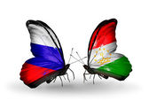 Two butterflies with flags of Russia and Tajikistan on wings — Stock Photo