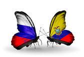 Dos mariposas con banderas de rusia y ecuador con alas — Foto de Stock