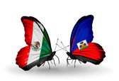 Two butterflies with flags of Mexico and Haiti on wings — Stock Photo