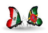 Two butterflies with flags of Mexico and Dominica on wings — Stock Photo