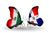 Two butterflies with flags of Mexico and Dominicana on wings — Stock Photo