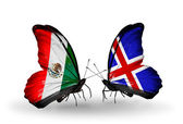 Two butterflies with flags of Mexico and Iceland on wings — Stok fotoğraf